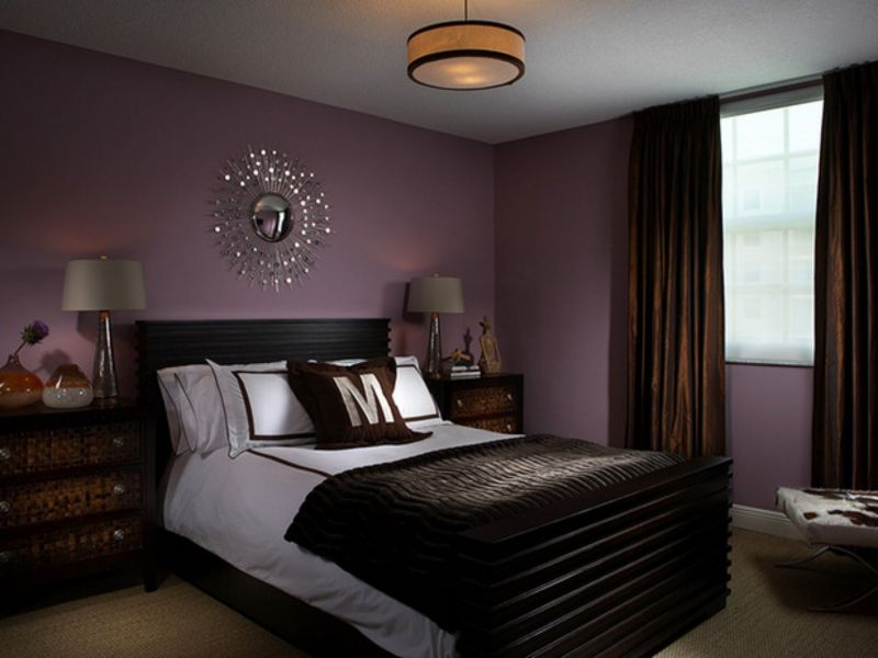 Unusual purple color in the bedroom with dark bed linen and curtains