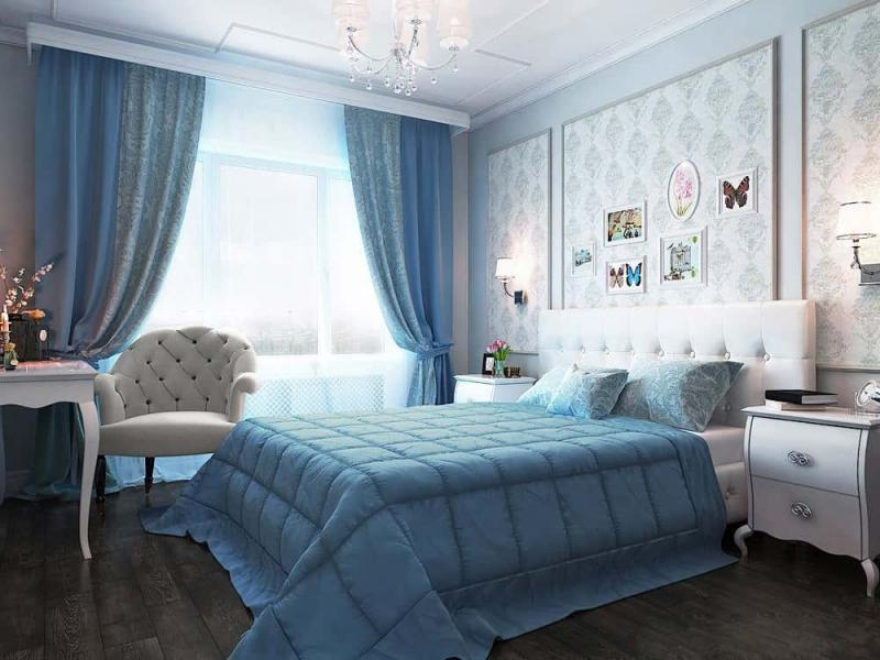 Neat blue tints for the Classic styled bedroom with quilted white armchair