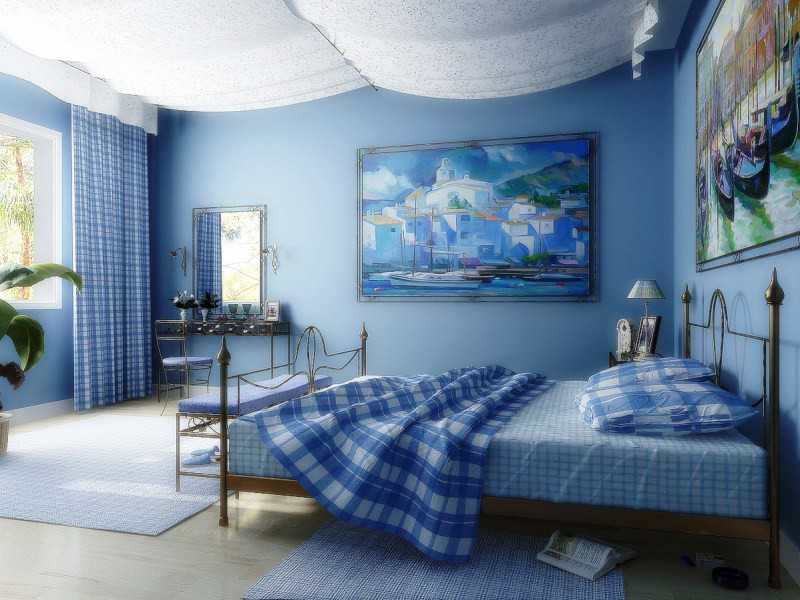Blue colored wallpaper and the suspended white ceiling in the bedroom
