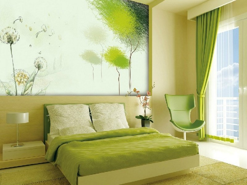 Green spring interior in the bedroom with relaxing armchair
