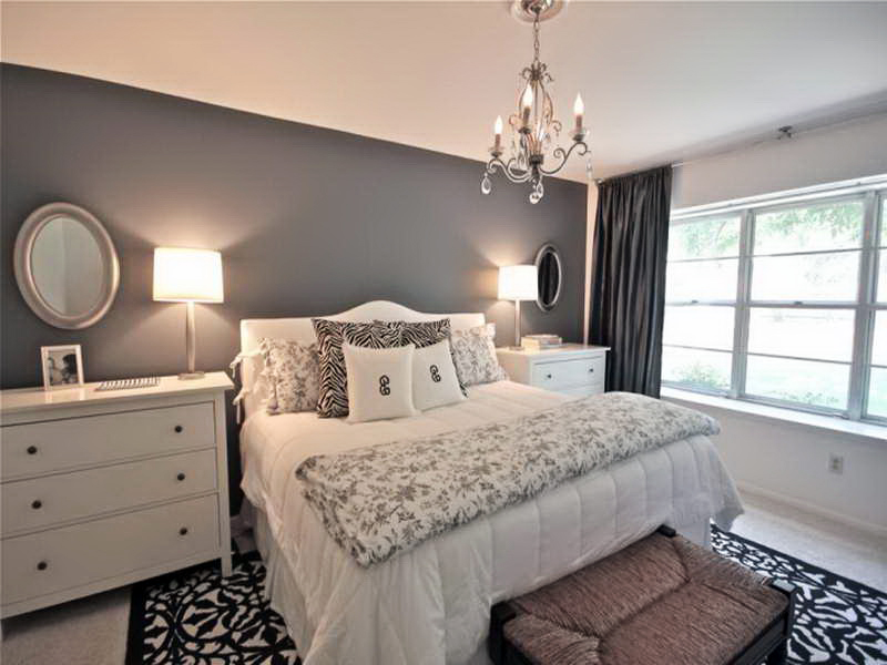 Gray colored headboard wall in the Classic bedroom with king size bed