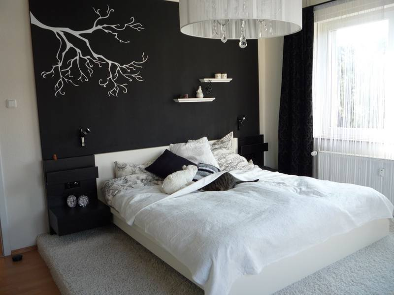 Black wall and the white interior decoration in the bedroom