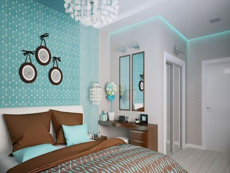 Classic styled bedroom with turquoise color scheme and white walls