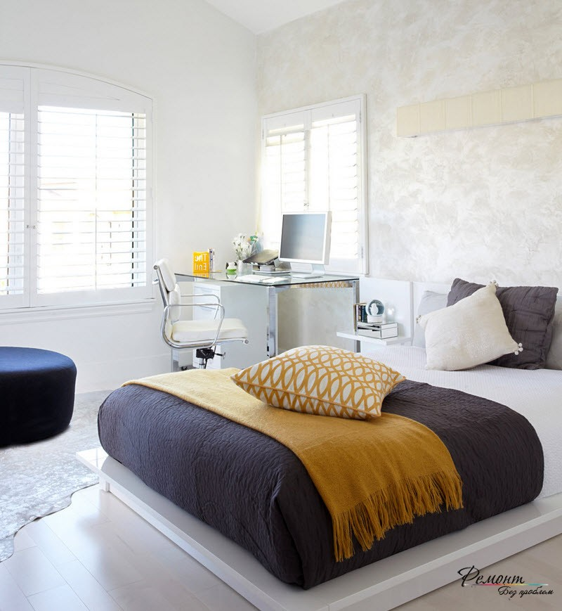 Home Office in the Bedroom: Is it the Right Place? All-white glossy interior with dark spots of bed and working corner near the window