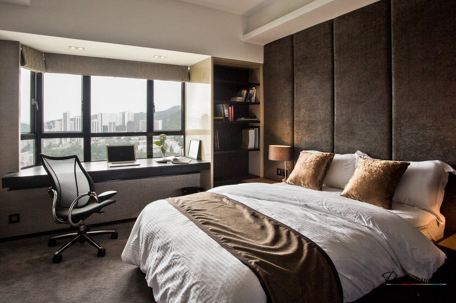 Home Office in the Bedroom: Is it the Right Place? Working zone at the windowsill of the ultramodern room in dark colors