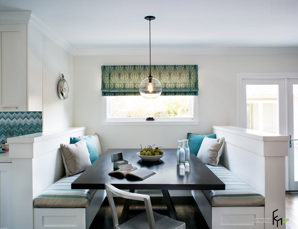 Dining Area with Corner Furniture Set. White designed dining near the kitchen with black table