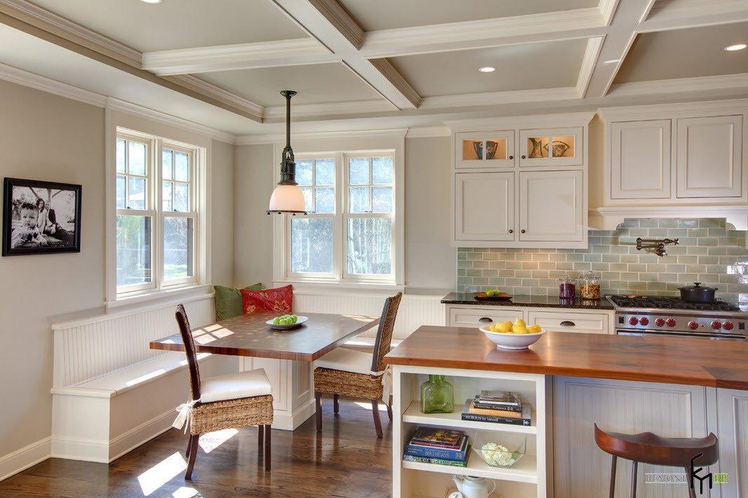 Dining Area with Corner Furniture Set. Coffered ceiling for classic American designed kitchen