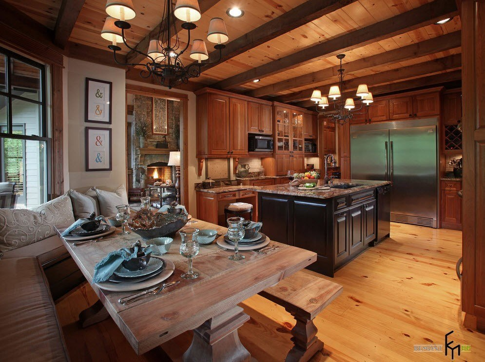 Wooden trimmed kitchen with open ceiling beams