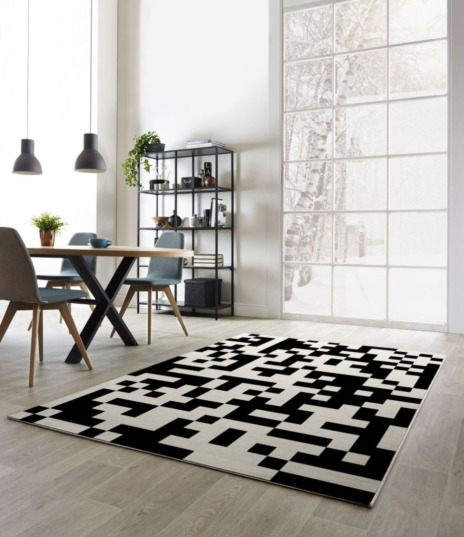 Black colored rug in the minimalistic interior