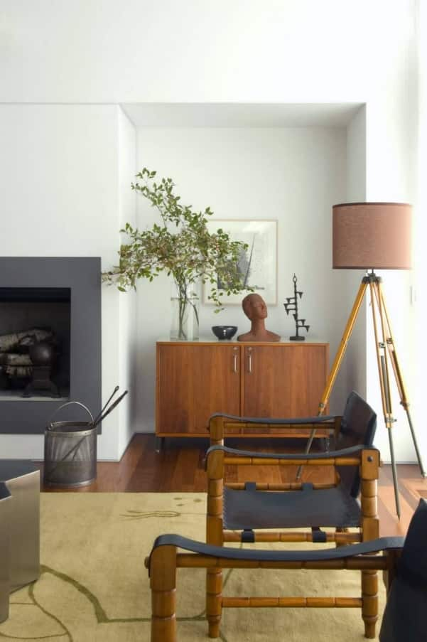 Storage Inspiration for Smaller Homes. Living rom with the fireplace and the alcove with the chest of drawers