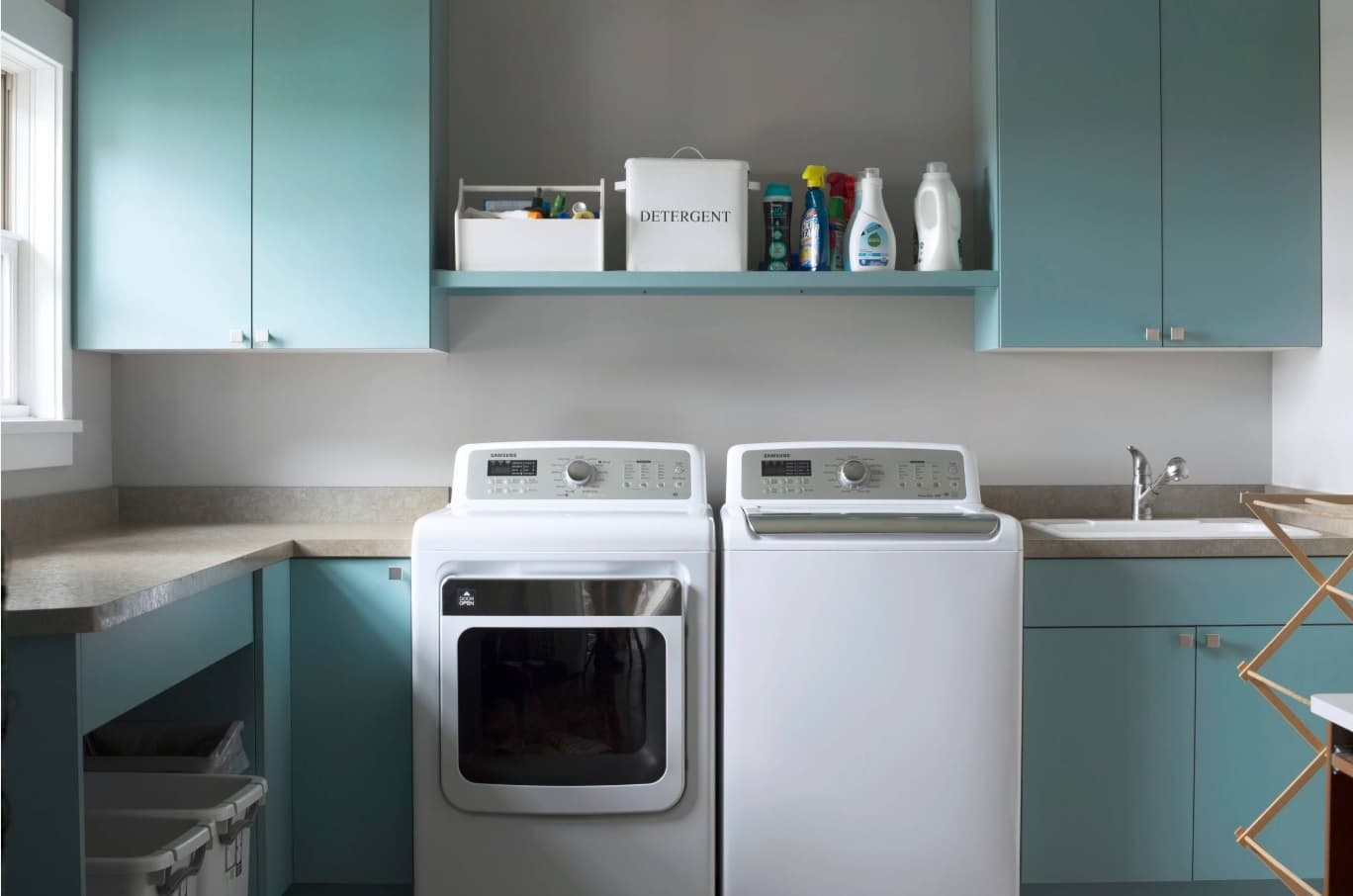 Proper Cleaning and Maintenance of Washers and Dryers. Washing and drying machines in the interior of the house laundry