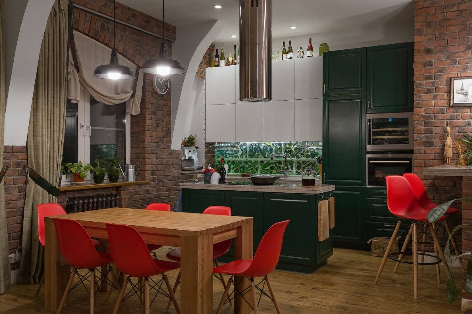 Fitted Kitchens: Impeccable Style and Functionality for any Space. Dark emerald color for the classic kitchen facades along with tubular extractor hood over the island