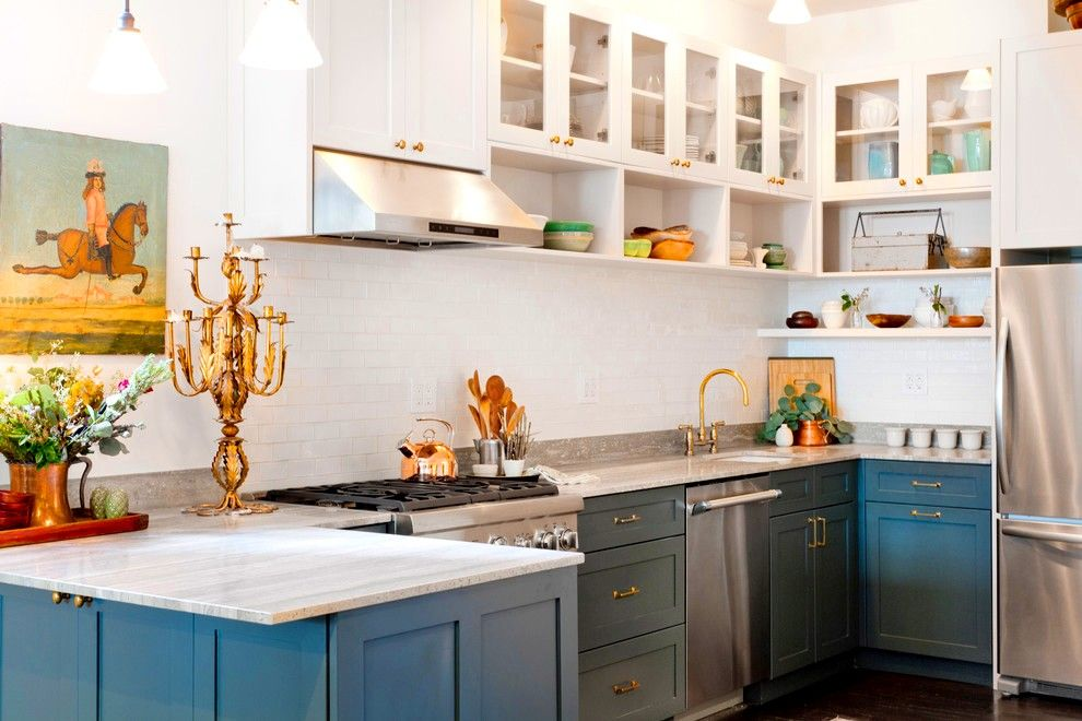 Fitted Kitchens: Impeccable Style and Functionality for any Space. Unusual rusticality in the white colored space with dark blue bottom furniture