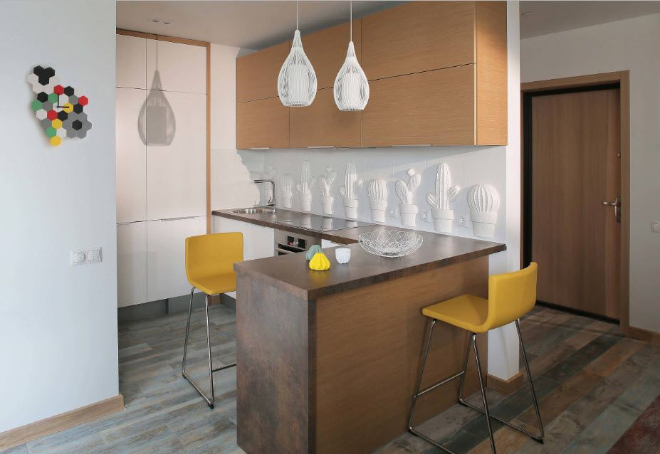 Fitted Kitchens: Impeccable Style and Functionality for any Space. Plastic yellow chairs at the tabletop-bar