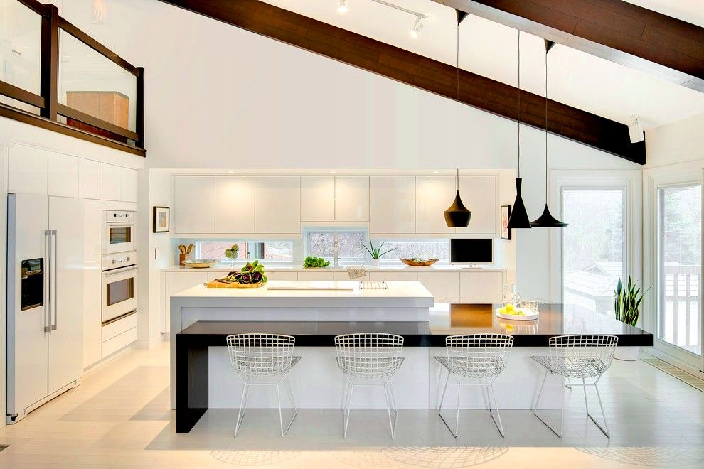 Open wooden ceiling beam as dark contrast for modern styled kitchen