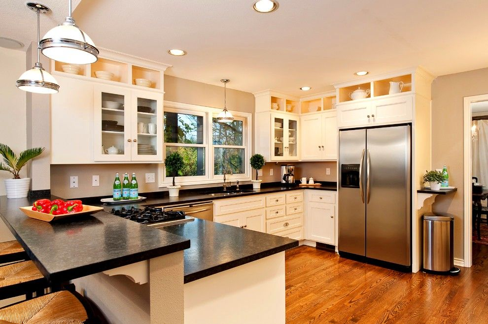 Casual kitchen with dark countertops and white ceiling