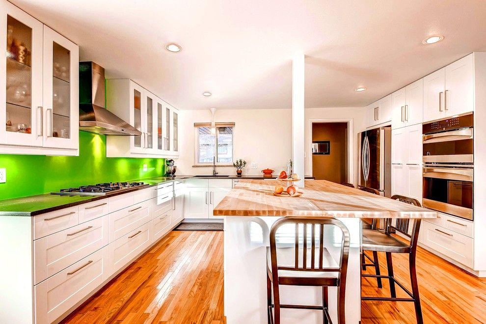Large private house kitchen with dining zone at the island