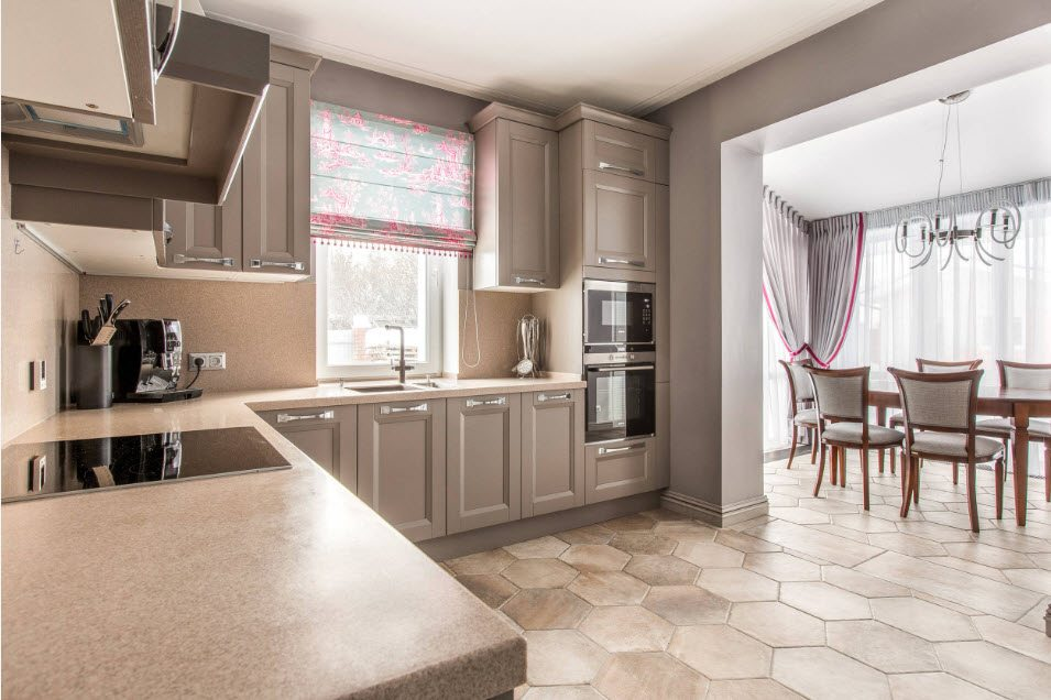 Arch separated kitchen and dining area in large apartment