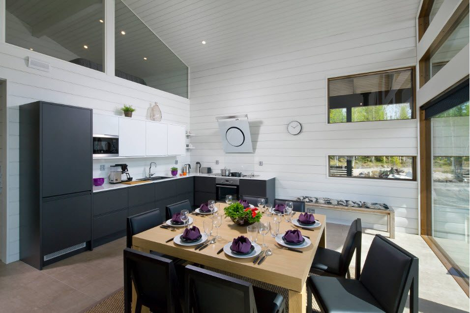 Fitted Kitchens: Impeccable Style and Functionality for any Space. White painted walls and dark gray furniture facades