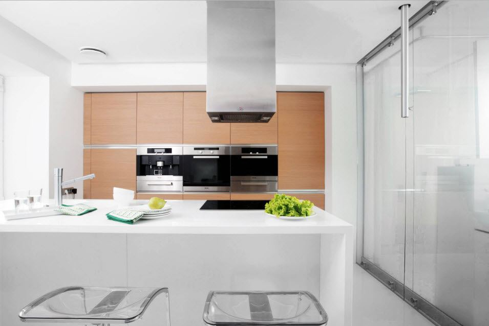 Modern designed kitchen with the long island in the center and white color theme