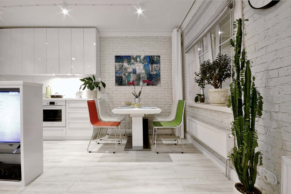 Large kitchen in all-white scheme with the dining area at the window