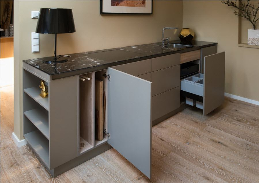 Multifunctional design of the furniture set for the fitted kitchen