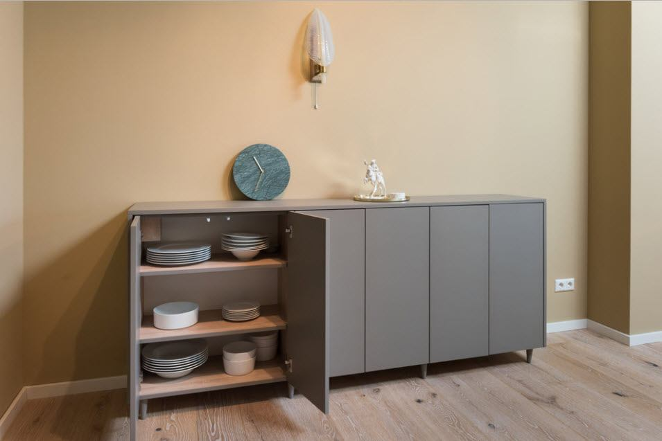 Separate gray cupboard for the section designed fitted kitchen