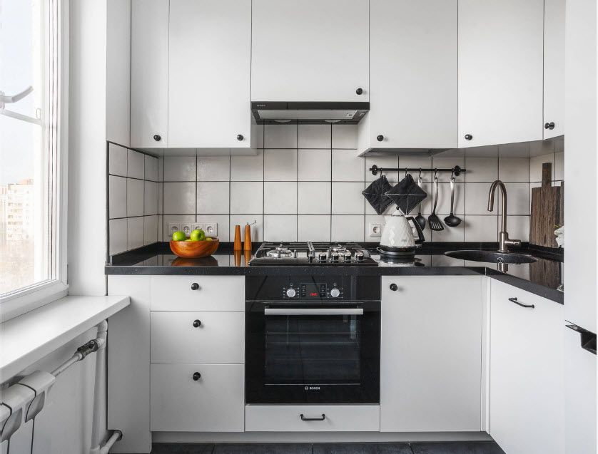 Fitted Kitchens: Impeccable Style and Functionality for any Space. white designed kitchen and uniform facades of the furniture set