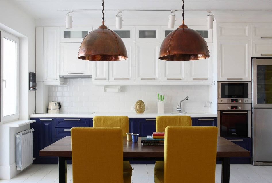 Fitted Kitchens: Impeccable Style and Functionality for any Space. Striking bronze lampshades over the dining table