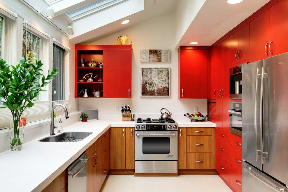 Fitted Kitchens: Impeccable Style and Functionality for any Space. Red colored top tier of the facades and wooden bottom for the furniture set design