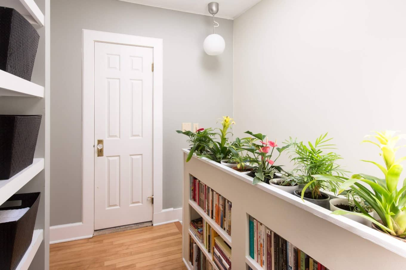 Storage Inspiration for Smaller Homes. The hallway with bookshelf with the pots for flowers at the top