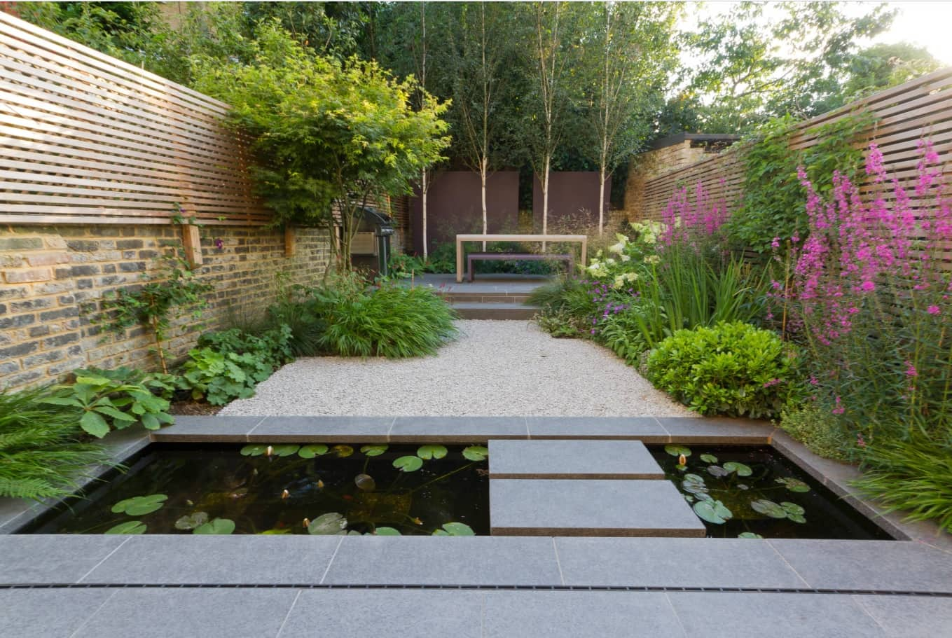 How to Use Outdoor Space Effectively. Artificial pond and blossoming plants