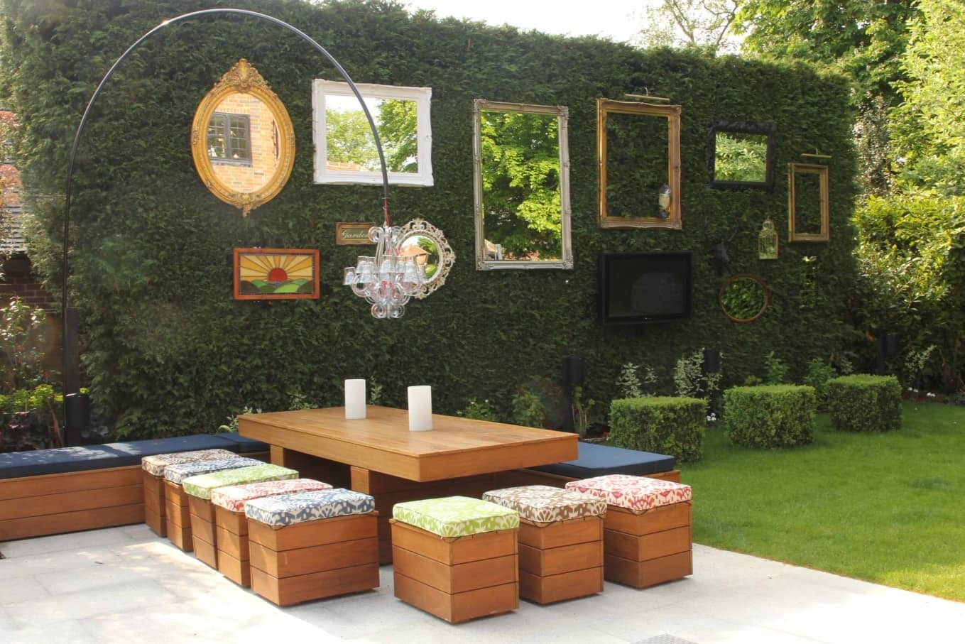 How to Use Outdoor Space Effectively. Rest zone decorated with live green wall and mirrors