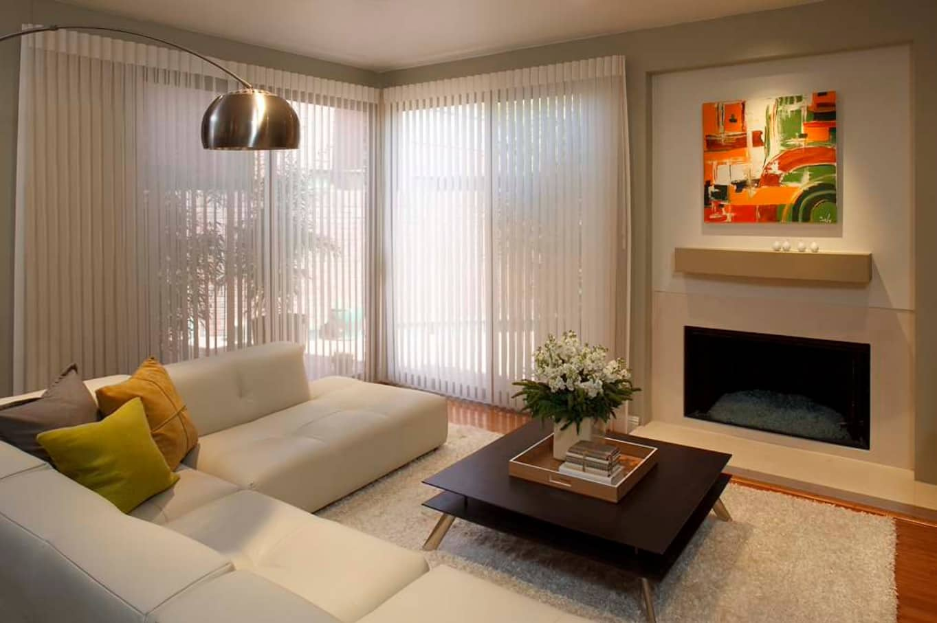 Using Vertical Blinds to Complement Interior Decor. Modern styled living room with angular panoramic window