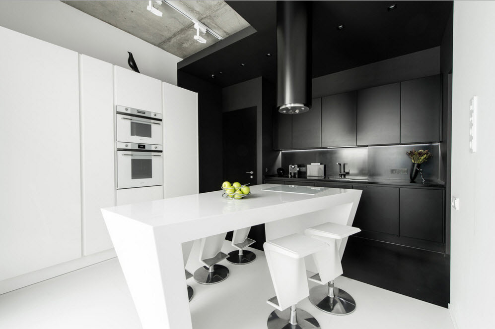 Daring Black and White Home Design Project with Neon Lighting. Spacious kitchen zone in modern style with glossy surfaces and island