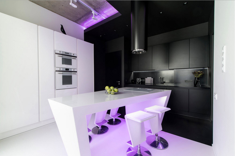 Daring Black and White Home Design Project with Neon Lighting. Modern kitchen with purple backlight