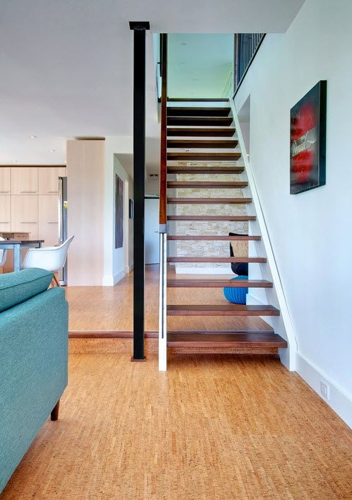 Nice house interior with wooden imitating cork floor and the stairs