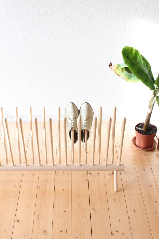 Custom Shoe Rack DIY Construction at Home. Unusual approach for footwear storage made of wooden rods