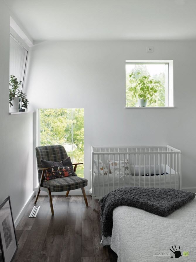 Nursery Interior Design Ideas with Photos and Practical Advice. All-gray colour theme for the small room with armchair and unusual windows