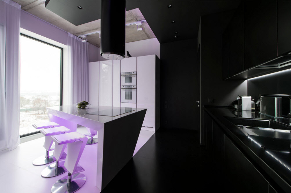 Daring Black and White Home Design Project with Neon Lighting. Unusual steel round extractor hood above the glancing plastic covered kitchen island