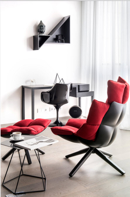Daring Black and White Home Design Project with Neon Lighting. Sectional red and black shairs