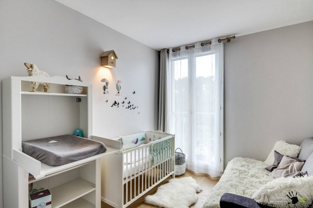 Small boxed nursery with gray walls and white ceiling