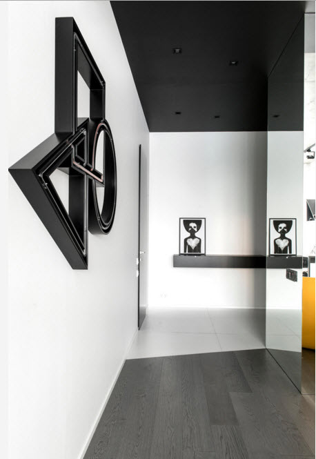 Daring Black and White Home Design Project with Neon Lighting. Unusual installatino in the wall