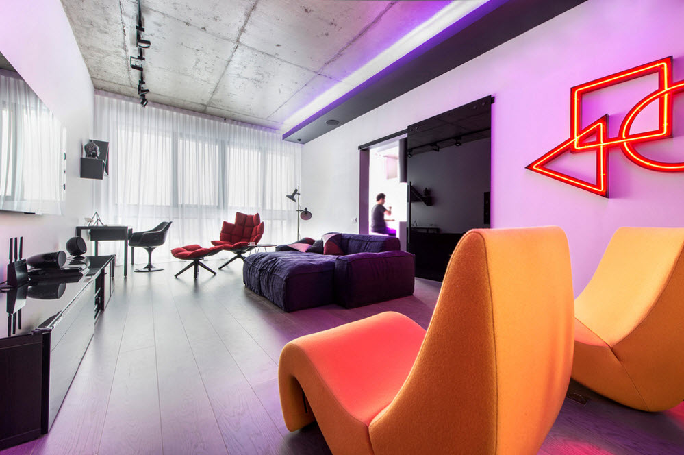Daring Black and White Home Design Project with Neon Lighting. Changing the colors under the backlight in cutting edge Industrial interior