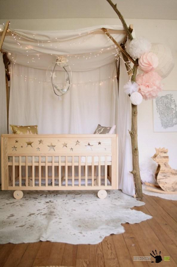 Wooden crib on the pelt and the canopy for the nursery