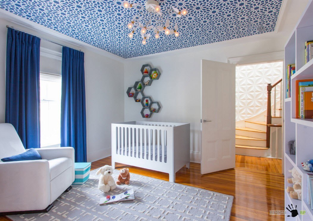 Blue color theme for the nursery with white wooden crib