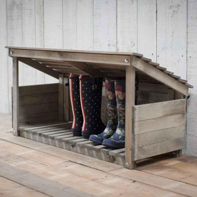 Aged wooden shoe rack with sloped top