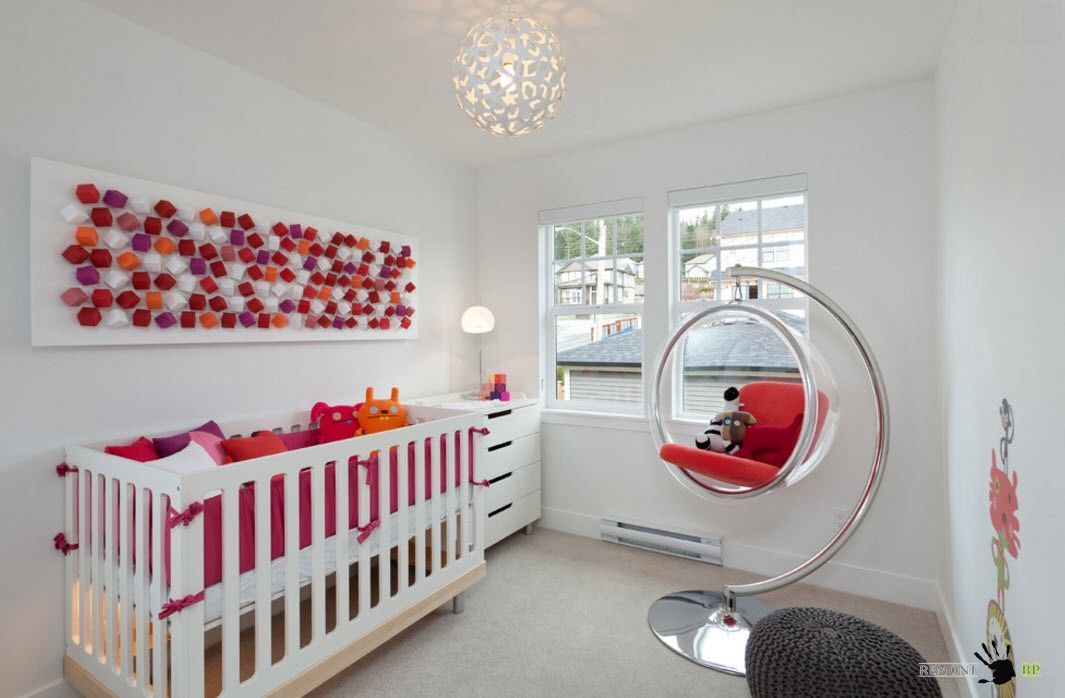 Bubble chair and red touch for the modern nursery