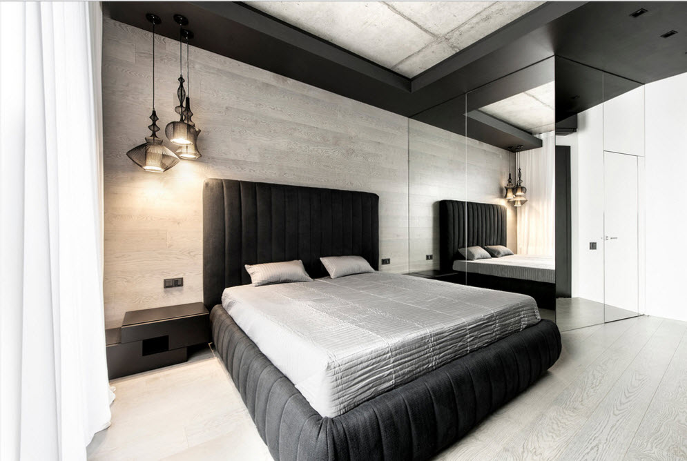 Unusual gray laminate imitating headboard panels and mirror partition for modern styled bedroom