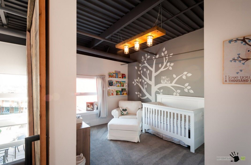 Unusual modern rustic touch in the lighting and ceiling of the small nursery